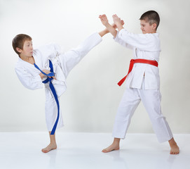 Children trained kick leg and block