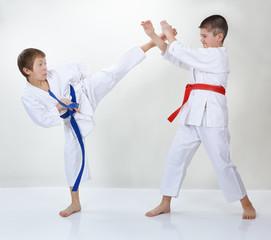 Children trained kick leg and block