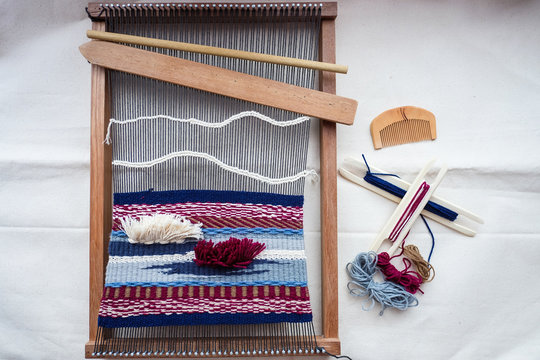 topview of tools and thread for weaving, hand loom for weaving