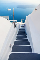 Beautiful view of volcano in Santorini with stairs in foreground