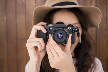 Hipster woman taking a picture
