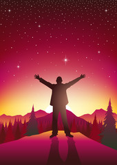 Man figure with open arms on top of hills