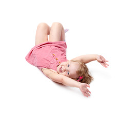 Young little girl lying over isolated white background
