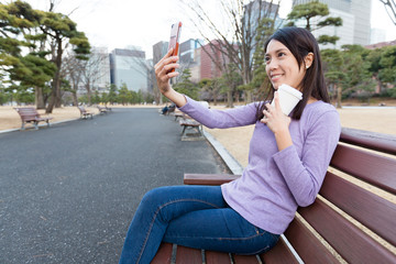 Woman take self image at outdoor park