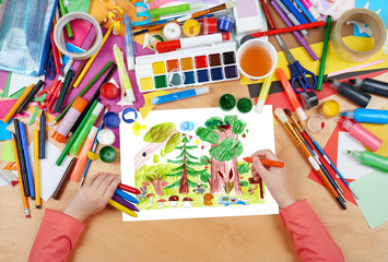 forest and wildlife animals child drawing, top view hands with pencil painting picture on paper, artwork workplace