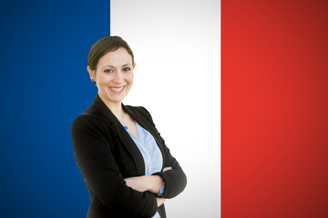 Young teacher standing before of the french flag