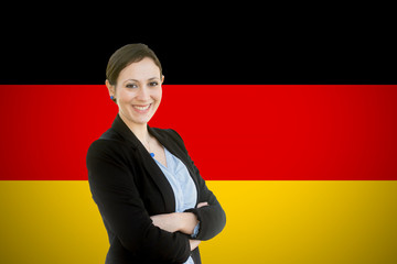 Young teacher standing before of the german flag