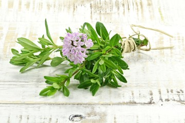 bunch of thyme on wooden background