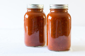 spaghetti sauce in a jar on a white background