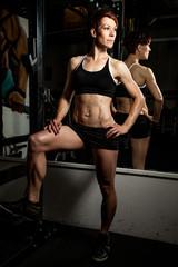 Young fit caucasian female bodybuilder