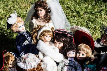 vintage and old ceramic dolls for collection at garage sale