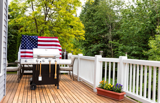 Home outdoor patio with BBQ cooker preparing for holiday picnic