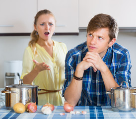 man and frustrated housewife having bad argument