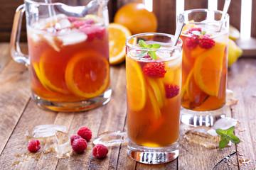 Iced tea with orange and raspberry
