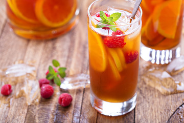 Iced tea with orange and raspberry
