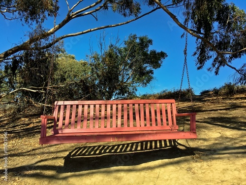 Remarkable Empty Rustic Wooden Bench Swing Hanging On A Tree In A Caraccident5 Cool Chair Designs And Ideas Caraccident5Info