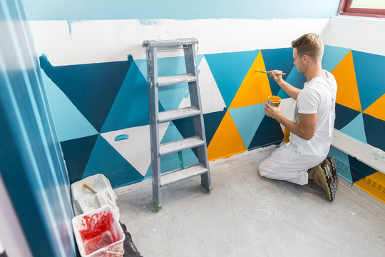 young apprentice painter in professional training
