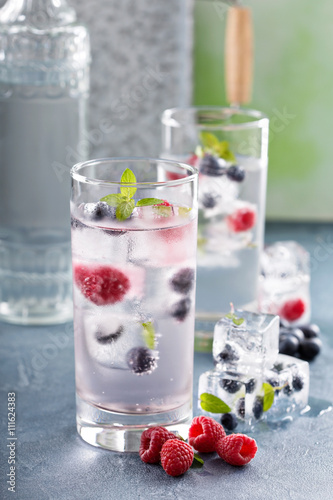 "Sparkling water with berry and herb ice"" Stock photo and royalty-free ..."