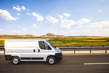 White delivery van on the road with colorful background