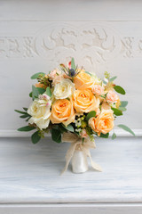 Beauty of yellow flowers. Bridal accessories. Close-up bunch of florets. Details for marriage and for married couple. Wedding bouquet with yellow roses and ribbons