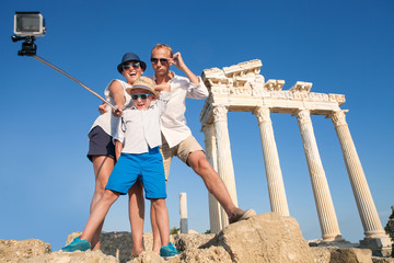 Family take a selfie video on the antique colonnade view