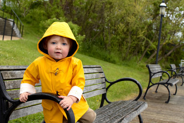 young boy in raincoat