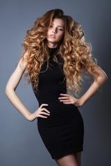 Full Length Portrait of a Sexy Blonde Woman in Little Black dress
