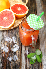 Grapefruit juice in glass jar