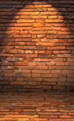 Low key photo of red brick wall with lighting effect. dark toned color of red brick wall. old and grunge brick wall. Brick wall for background