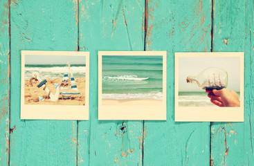 instant polaroid photos album on wooden background