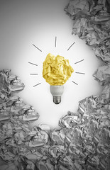 New idea concept with black and white background crumpled office paper and light bulb