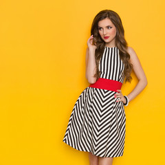 Elegant Woman In Striped Dress Looking Away