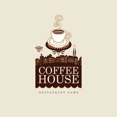 banner for coffee house with cup against the backdrop of the old town