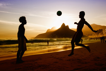 Two soccer players at beach at Rio de Janeiro