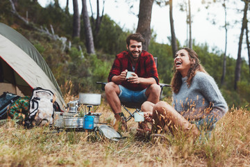 Young couple having the best time at camping