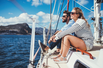Young couple sitting on yacht in sea