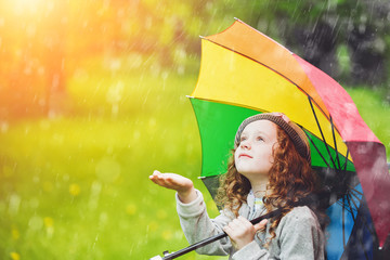 Black and white portrait, little girl enjoy to spring rain.