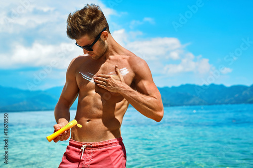 Man Skin Care In Summer Handsome Male With Y Body Sungles Lying Uv Protective