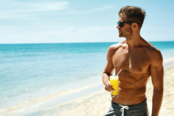 Summer Relax. Portrait Of Athletic Sexy Man With Muscular Body Drinking Fresh Juice Smoothie...