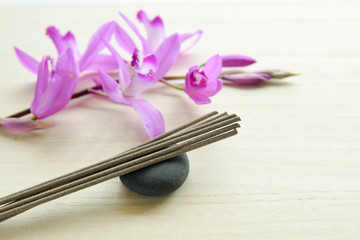 stick incense and orchid