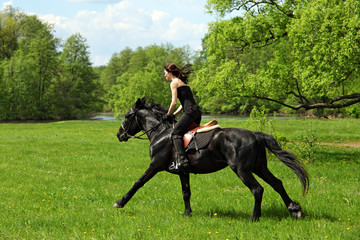 Young woman on horse - afternoon trail ride