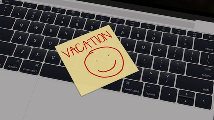 vacation - Laptop with yellow sticky note