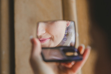 Gorgeous beautiful bride with green eyes mirror reflection face closeup