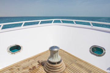 View from the bow of a luxury yacht over tropical sea