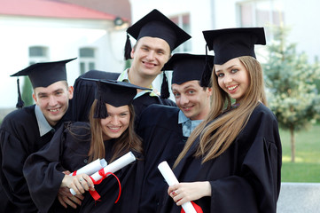 Five students celebrating the completion of university