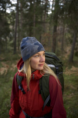 A woman walking in the forest, Sweden.