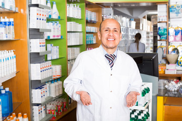 Male pharmacist in drugstore.