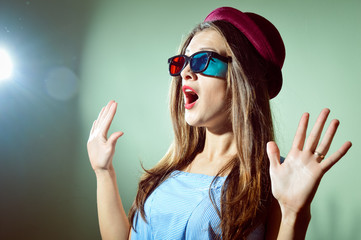 Surprised young pretty woman in 3d glasses looking amazed. Beautiful elegant romantic female