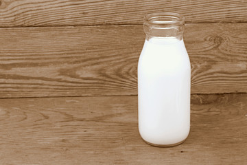 Milk and old style bottle on wood table