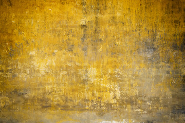 Real wall background, grungy yellow texture.